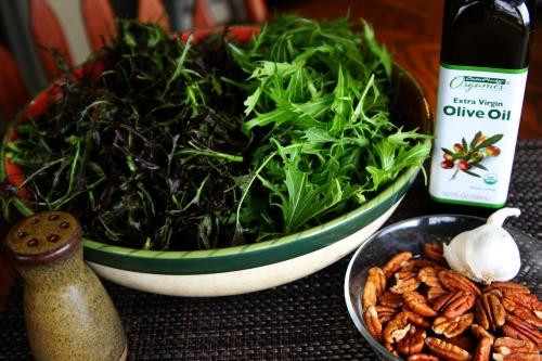 Mustard greens, salt, olive oil, pecans and garlic